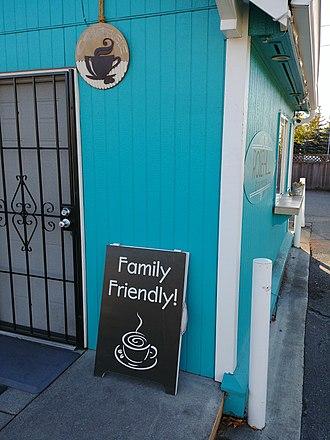 "Bikini barista - A suburban Seattle espresso stand advertising that it is ""family friendly"", i.e. not served by bikini baristas"