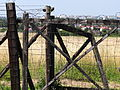 Fenceposts and Fencing with Lublin City at Rear - Majdanek Concentration Camp - Lublin - Poland - 02.jpg