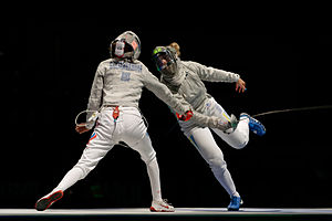Olha Kharlan - Kharlan (R) scores against Galiakbarova in the women's team sabre final of the 2013 World Championships