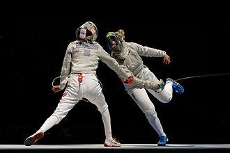 Olha Kharlan - Kharlan (R) scores against Galiakbarova in the women's team sabre final of the 2013 World Championships