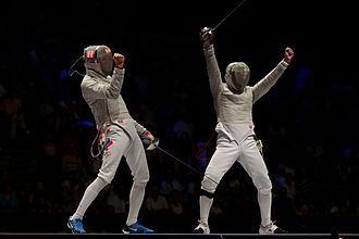 Sabre (fencing) - Veniamin Reshetnikov (L) and Nikolay Kovalev (R) both claim the hit; the referee must decide who scores the point. Final of the 2013 World Fencing Championships.