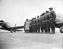 Major James A. Ellison returns the salute of Mac Ross, as he reviews the first class of Tuskegee cadets; flight line at U.S. Army Air Corps basic and ...
