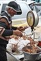 Fisherman selling lobsters (4548332580).jpg