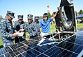Flickr - Official U.S. Navy Imagery - Sailors examine a solar-powered car..jpg