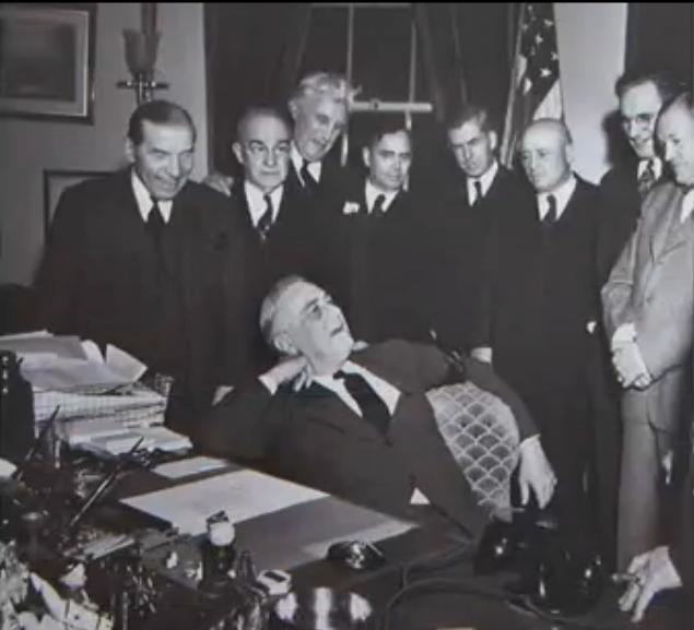 Franklin Delano Roosevelt and smiling staff.
