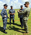 From left, U.S. Navy Capt. Michael Jacobsen, the U.S. Naval Forces Southern Command chief of staff, U.S. 4th Fleet, talks with Capt. Kurt Hedberg, the Southern Partnership Station (SPS) 2010 mission commander 100825-N-EP471-353.jpg