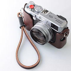 Fujifilm FinePix X100 with Handmade Leather Camera Strap.jpg