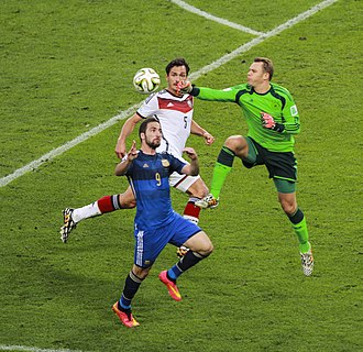 2014 FIFA World Cup Final - Argentina striker Gonzalo Higuaín challenging Germany goalkeeper Manuel Neuer.