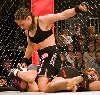 MMA gloves - Gina Carano wears MMA gloves during a bout.