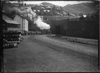 NZR T class - Goods train with T class locomotive leaving Lyttelton, ca. 1904
