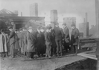 Grand jury - A grand jury investigating the fire that destroyed the Arcadia Hotel in Boston, Massachusetts in 1913