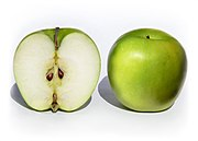 A cross section and whole Granny Smith