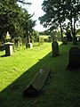 Graves in the churchyard at St James, Cardington - geograph.org.uk - 1446010.jpg