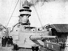 A large turret with two guns on a warship