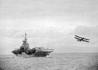 HMS Formidable (67) - An Albacore just having taken off with two more ranged on deck, 1942