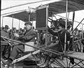 Harvey Crawford and biplane in Tacoma 1912.jpg