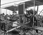 Harvey Crawford and biplane in Tacoma 1912.jpg