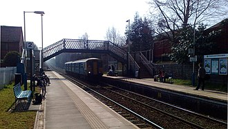 Hawarden railway station - A Class 150 DMU arrives at Hawarden with a service to Bidston
