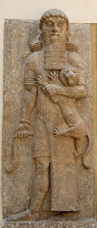 Enkidu - Possible representation of Enkidu as Master of Animals grasping a lion and snake, in an Assyrian palace relief, from Dur-Sharrukin, now Louvre