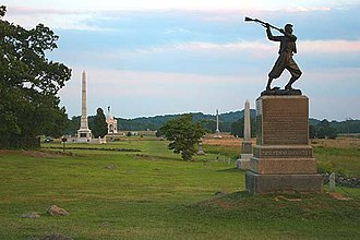 Pickett's Charge - Cemetery Ridge, looking south along the ridge with Little Round Top and Big Round Top in the distance. The monument in the foreground is the 72nd Pennsylvania Infantry Monument.