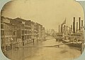 High water at St. Louis (flooded levee and front street, Str. Platte Valley at right) 15 June 1858.jpg