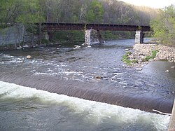 Hoosic River railroad bridge and weir North Adams