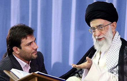 Khamenei during a meeting with Qaris Hossein Fardi and Supreme Leader Ayatollah Khamenei.jpg