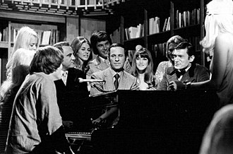 Playboy After Dark - With guest Don Adams (at piano), Barbie Benton, and Hugh Hefner. Center back are Lindsay Wagner, later the Bionic Woman, and Yorick Wilks, 1970.