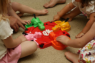 Hungry Hungry Hippos - Hungry Hungry Hippos being played by four players