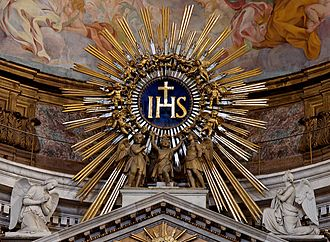 Holy Name of Jesus - IHS monogram, with kneeling angels, atop the main altar, Church of the Gesù, Rome.