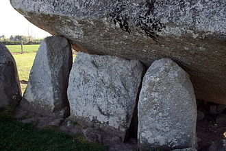 Brownshill dolmen - Gate-stone flanked by the two portal stones supporting the capstone
