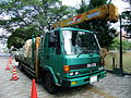 ISUZU FORWARD Green truck with crane.jpg