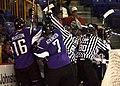 Ice hockey players wearing helmet fight.jpg