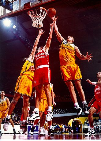 Rebound (basketball) - Iñaki de Miguel, Spanish basketball player, capturing a rebound in an international game.