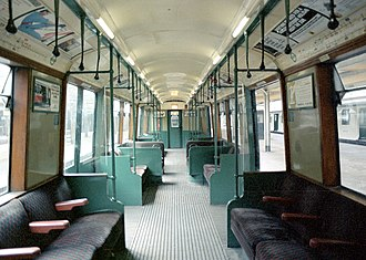 London Underground R Stock - Inside an R stock non driving motor (NDM). These had two windows in the central saloon between the double doors, and one set of transverse seats in the centre bay.