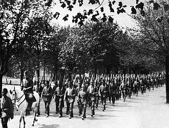 27th Jäger Battalion (Finland) - The pioneer company of the battalion returning from a parade in Liepāja (Libau). The company commander riding on the white horse is lieutenant Basse. The battalion stayed almost a year in Liepāja for special training in 1917 after the Riga Bay period of 1916.