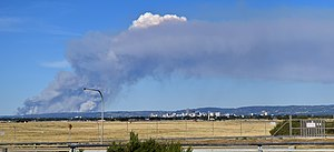 2015 Sampson Flat bushfires - A plume of smoke emerging from the Adelaide Hills region during the bushfires, 2 January 2015. The Adelaide city centre is the cluster of buildings visible centre right.