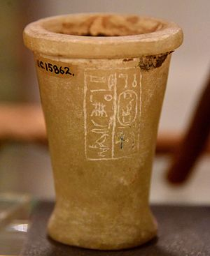 Hatshepsut - Jar bearing the cartouche of Hatshepsut. Filled in with cedar resin. Calcite, unfinished. Foundation deposit. 18th Dynasty. From Deir el-Bahari, Egypt. The Petrie Museum of Egyptian Archaeology, London