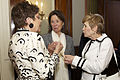 Jeanne Vander Myde Warner, center, the wife of retired U.S. Sen. John Warner, the Evening Parade guest of honor and a former secretary of the Navy, speaks with Ellyn Dunford, right, the wife of U.S. Marine Corps 130503-M-LU710-092.jpg