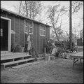 Jerome Relocation Center, Denson, Arkansas. Mrs. T. Arima busily prepares her doorstep garden in Bl . . . - NARA - 538836.tif