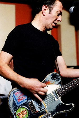 Joe Strummer - Strummer in 2001 with his guitar