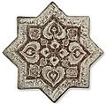 Kashan lustre-decorated star tile, Central Persia, 14th Century, Christie's sale 2835 Dec. 2009.jpg