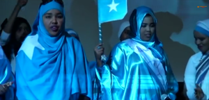 Flag of Somalia - Somali women at a Khatumo State launch ceremony wearing the Somali flag.
