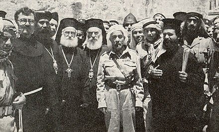King Abdullah outside the Church of the Holy Sepulchre, 29 May 1948, the day after Jordanian forces took control of the Old City in the Battle for Jerusalem King Abdullah, Jerusalem, 29 May 1948.jpg
