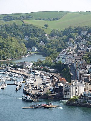 Kingswear - Kingswear, seen from above Dartmouth. The railway station, passenger ferry and lower vehicle ferry can all be seen, as can Lower Street climbing away from the riverside.