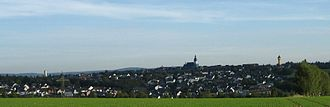 "Kirchberg, Rhein-Hunsrück - View from the north of Kirchberg with the three towers: watertower, Saint Michael's Church and Friedenskirche (""Peace Church"")"