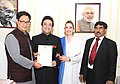 Kiren Rijiju presenting certificate of Indian citizenship to Adnan Sami.jpg