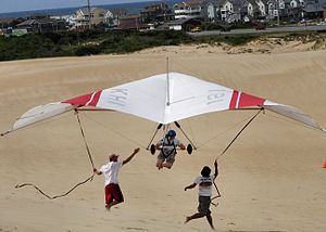 Learning to hang glide over sand dunes.
