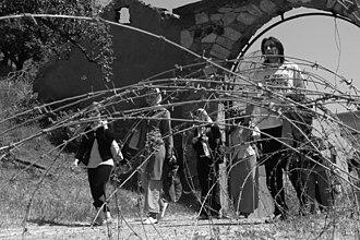 Devič - Serbs leaving monastery after 2004 unrest