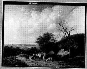 Heuvelig landschap met herder en kudde op een zandweg